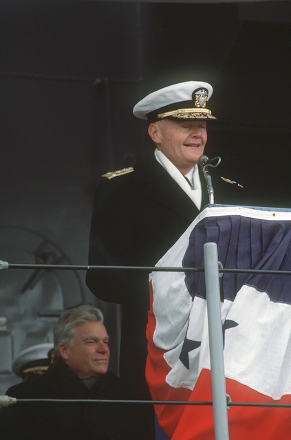 Vice Admiral (VADM) William F. McCauley, commander, Naval Surface Force, US Atlantic Fleet, reads the commissioning directive during the commissioning of the salvage ship USS GRASP (ARS 51)