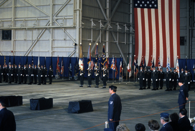 A 101st Airborne Division color guard and honor guard stand at attention during an honor ceremony for members of the 3rd Battalion, 502nd Infantry, 101st Airborne Division. On December 12, 1985, 248 soldiers of the 3rd Battaliion were killed in a plane crash at Gander Airport. They were returning to the United States after participating in peacekeeping duty with the Multinational Force and Observers in the Sinai Desert