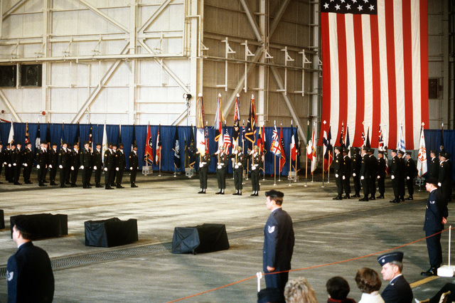 A 101st Airborne Division honor guard and color guard stand at attention during a memorial service for 248 members of the 3rd Bn., 502nd Inf., 101st Airborne Div., who were killed in plane crash at Gander Airport, Newfoundland, Canada, on December 12, 1985. The 3rd Battalion was returning to the United States after participating in peacekeeping duty with the Multi-national Force and Observers in the Sinai Desert