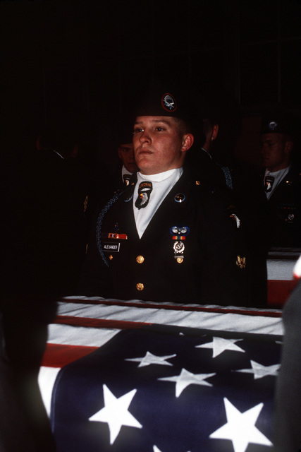A 101st Airborne Division honor guard helps hold a casket containing the remains of members of the 3rd Bn., 502nd Inf., 101st Airborne Div. On December 12, 1985, 248 soldiers of the 3rd Battalion were killed in a plane crash at the Gander Airport. They were returning to the United States after participating in peacekeeping duty with the Multi-national Force and Observers in the Sinai Desert