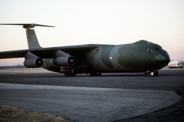 A 437th Military Airlift Wing C-141B Starlifter aircraft carrying the remains of members of the 3rd Bn., 502nd Inf., 101st Airborne Div., arrives at the base. On December 12, 1985, 248 soldiers of the 3rd Battalion were killed in a plane crash at Gander Airport, Newfoundland, Canada. They were returning to the United States after participating in peacekeeping duty with the Multi-national Force and Observers in the Sinai Desert