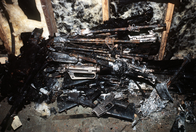 Charred weapons recovered from the wreckage of an Arrow Air DC-8 commercial aircraft are stored in a Gander Airport hangar for analysis by members of the Canadian Air Safety Board. The aircraft crashed at the airport with no survivors on December 12, 1985, while carrying 248 members of the 3rd Bn., 502nd Inf., 101st Airborne Div. They were returning to the United States after participating in peacekeeping duty with the Multi-national Force and Observers in the Sinai Desert
