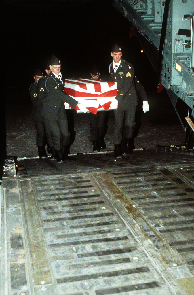 Members of the 101st Airborne Division Honor Guard carry a casket containing the remains of a member of the 3rd Bn., 502nd Inf., 101st Airborne Div., into a 437th Military Airlift Wing C-141B Starlifter aircraft for a flight to Dover Air Force Base, Delaware. On December 12, 1985, 248 soldiers of the 3rd Battalion were killed in plane crash at airport. They were returning to the United States after participating in peacekeeping duty with the Multi-national Force and Observers in the Sinai Desert