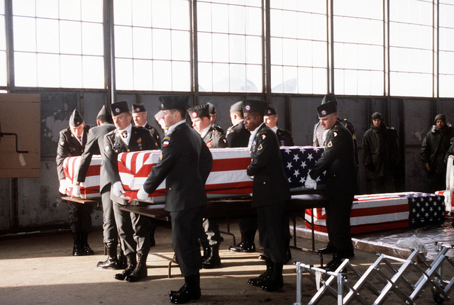 Members of the 101st Airborne Division Honor Guard carry a casket containing the remains of a member of the 3rd Bn., 502nd Inf., 101st Airborne Div., out of a temporary morgue at Gander Airport. On December 12, 1985, 248 soldiers of the 3rd Battalion were killed in plane crash at Gander Airport, Newfoundland, Canada, They were returning to the United States after participating in peacekeeping duty with the Multi-national Force and Observers in the Sinai Desert
