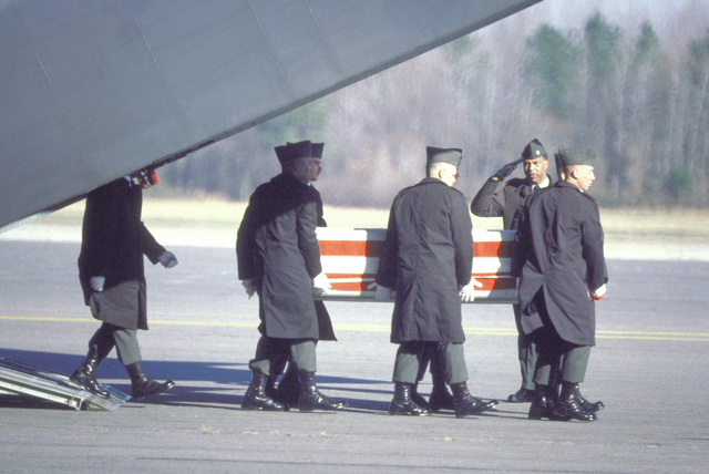 Members of the 101st Airborne Division Honor Guard carry a casket containing the remains of a member of the 3rd Battalion, 502nd Infantry, 101st Airborne Division, out of a 437th Military Airlift Wing C-14B Starlifter aircraft. On December 12, 1985, 248 soldiers of the 3rd Battalion were killed in a plane crash at Gander Airport, Newfoundland, Canada. They were returning to the United States after participating in peacekeeping duty with the Mulinational Force and Observers in the Sinai Desert