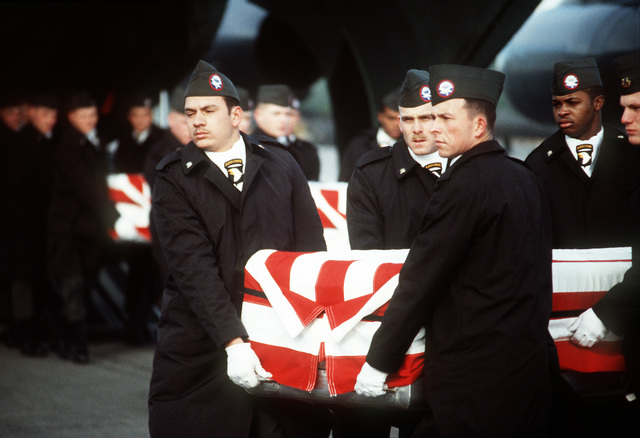 Members of the 101st Airborne Division Honor Guard carry a casket containing the remains of a member of the 3rd Bn., 502nd Inf., 101st Airborne Div., out of a 437th Military Airlift Wing C-141B Starlifter aircraft. On December 12, 1985, 248 soldiers of the 3rd Battalion were killed in plane crash at Gander Airport, Newfoundland, Canada, They were returning to the United States after participating in peacekeeping duty with the Multi-national Force and Observers in the Sinai Desert