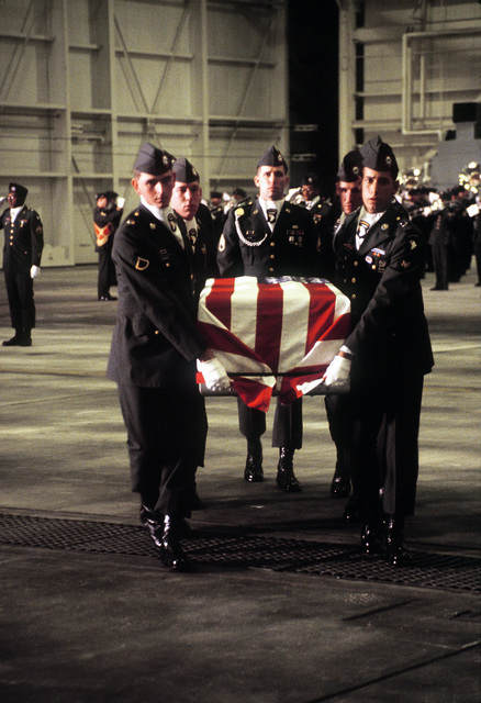 Members of the 101st Airborne Division Honor Guard carry a casket containing the remains of a member of the 3rd Bn., 502nd Inf., 101st Airborne Div., into a hangar for a memorial service. On December 12, 1985, 248 soldiers of the 3rd Battalion were killed in plane crash at Gander Airport, Newfoundland, Canada, They were returning to the United States after participating in peacekeeping duty with the Multi-national Force and Observers in the Sinai Desert