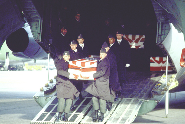 Members of the 101st Airborne Division Honor Guard carry a casket containing the remains of a member of the 3rd Battalion, 502nd Infantry, 101st Airborne Division out of a 437th Military Airlift Wing C-141B Starlifter aircraft. On December 12, 1985, 248 soldiers of the 3rd Battalion were killed in a plane crash at Gander Airport, Newfoundland, Canada. They were returning to the United States after participating in peacekeeping duty with the Mulinational Force and Observers in the Sinai Desert