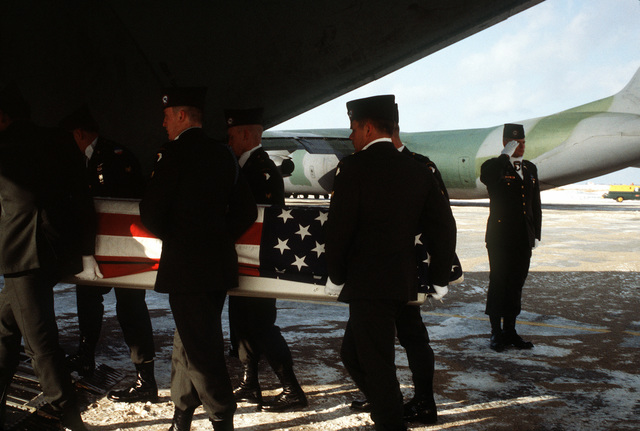 Members of the 101st Airborne Division Honor Guard carry a casket containing remains of members of the 3rd Bn., 502nd Inf., 101st Airborne Div., into a 437th Military Airlift Wing C-141B Starlifter aircraft for a flight to Dover Air Force Base, Delaware. On December 12, 1985, 248 soldiers of the 3rd Battalion were killed in a plane crash at the Gander Airport. They were returning to the United States after participating in peacekeeping duty with the Multi-national Force and Observers in the Sinai Desert
