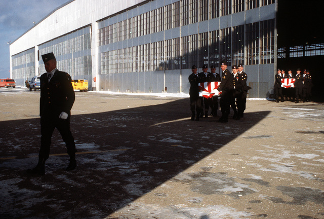 Members of the 101st Airborne Division Honor Guard carry caskets containing the remains of a member of the 3rd Bn., 502nd Inf., 101st Airborne Div., out of a temporary morgue at Gander Airport. On December 12, 1985, 248 soldiers of the 3rd Battalion were killed in plane crash at airport. They were returning to the United States after participating in peacekeeping duty with the Multi-national Force and Observers in the Sinai Desert