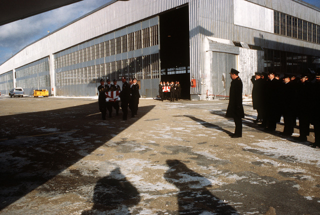 Members of the 101st Airborne Division Honor Guard carry caskets containing the remains of a member of the 3rd Bn., 502nd Inf., 101st Airborne Div., during out of a temporary morgue at Gander Airport. On December 12, 1985, 248 soldiers of the 3rd Battalion were killed in plane crash at airport. They were returning to the United States after participating in peacekeeping duty with the Multi-national Force and Observers in the Sinai Desert