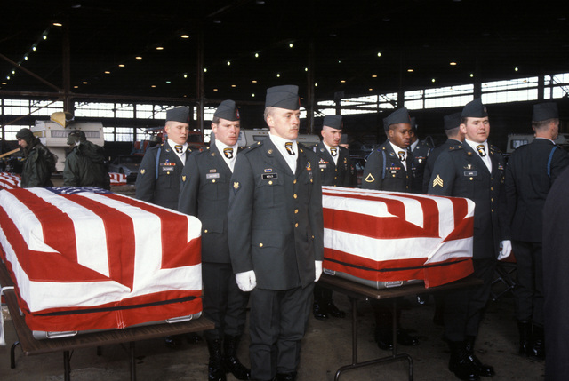 Members of the 101st Airborne Division Honor Guard prepare to carry caskets containing the remains of members of the 3rd Battalion, 502nd Infantry, 101st Airborne Division, to an aircraft for a flight to Dover Air Force Base, Delaware. On December 12, 1985, 248 soldiers of the 3rd Battaliion were killed in a plane crash at Gander Airport. They were returning to the United States after participating in peacekeeping duty with the Multi-national Force and Observers in the Sinai Desert