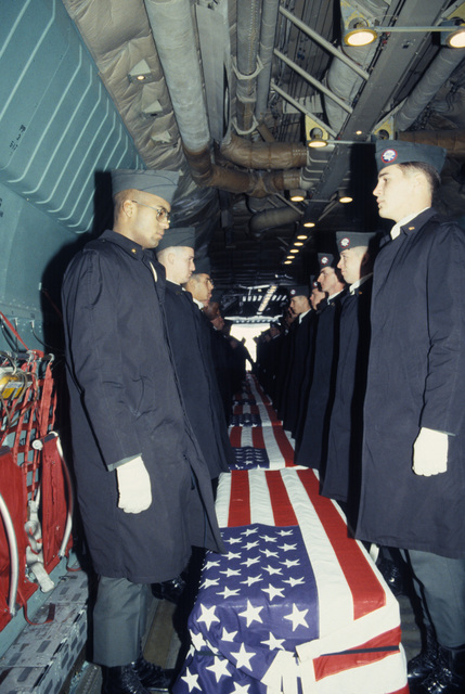 Members of the 101st Airborne Division Honor Guard prepare to carry caskets containing the remains of members of the 3rd Battalion, 502nd Infantry, 101st Airborne Division, out of a 437th Military Airlift Wng C-141B Starlifter aircraft. On December 12, 1985, 248 soldiers of the 3rd Battaliion were killed in a plane crash at Gander Airport, Newfoundland. They were returning to the United States after participating in peacekeeping duty with the Multinational Force and Observers in the Sinai Desert