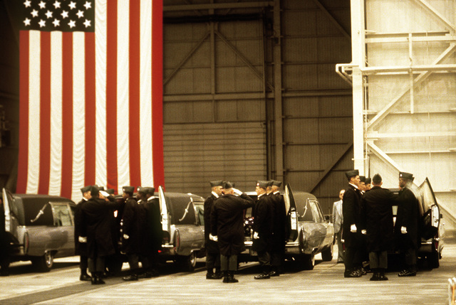 Members of the 101st Airborne Division prepare to carry caskets containing the remains of members of the 3rd Bn., 502nd Inf., 101st Airborne Div., from hearses into a hangar for a memorial service. On December 12, 1985, 248 soldiers of the 3rd Battalion were killed in a plane crash at the Gander Airport, Newfoundland, Canada. They were returning to the United States after participating in peacekeeping duty with the Multi-national Force and Observers in the Sinai Desert