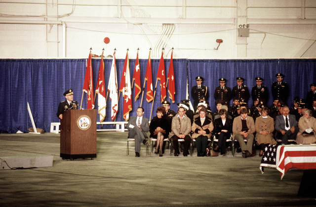 Mourners listen as General John A. Wickham Jr., CHIEF of Staff, U.S. Army, speaks during an honor ceremony for members of the 3rd Battalion, 502 Infantry, 101st Airborne Division, who were killed in a plane crash on December 12, 1985 at Gander Airport, Newfoundland, Canada. They were returning to the United States after participating in peacekeeping duty with the Multinational Force and Observers in the Sinai Desert