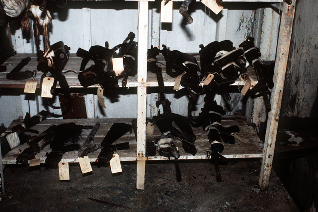 Weapons recovered from the wreckage of an Arrow Air DC-8 commercial aircraft are stored in a Gander Airport hangar for analysis by members of the Canadian Air Safety Board. The aircraft crashed at the airport with no survivors on December 12, 1985, while carrying 248 members of the 3rd Bn., 502nd Inf., 101st Airborne Div. They were returning to the United States after participating in peacekeeping duty with the Multi-national Force and Observers in the Sinai Desert