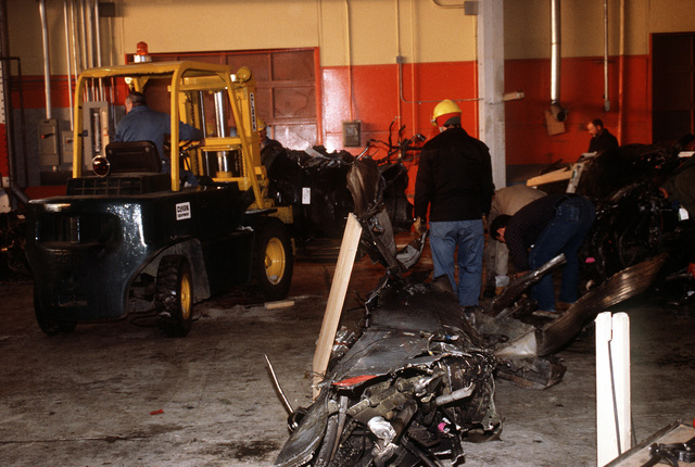 Wreckage from an Arrow Air DC-8 commercial aircraft are stored in a Gander Airport hangar for analyzed by members of the Canadian Air Safety Board. The aircraft crashed at the airport with no survivors on December 12, 1985, while carrying 248 members of the 3rd Bn., 502nd Inf., 101st Airborne Div. They were returning to the United States after participating in peacekeeping duty with the Multi-national Force and Observers in the Sinai Desert