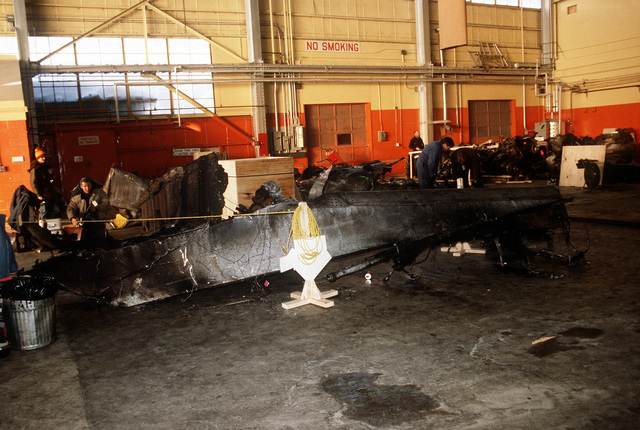 Wreckage from an Arrow Air DC-8 commercial aircraft is stored in a Gander Airport hangar for analysis by members of the Canadian Air Safety Board. The aircraft crashed at the airport with no survivors on December 12, 1985, while carrying 248 members of the 3rd Bn., 502nd Inf., 101st Airborne Div. They were returning to the United States after participating in peacekeeping duty with the Multi-national Force and Observers in the Sinai Desert