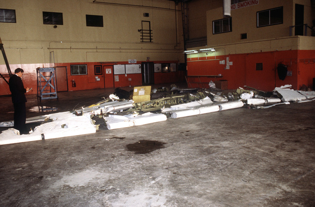 Wreckage from an Arrow Air DC-8 commercial aircraft is stored in a Gander Airport hangar for analysis by members of the Canadian Air Safety Board. The aircraft crashed at the airport with no survivors on December 12, 1985 while carrying 248 members of the 3rd Battalion, 502nd Infantry, 101st Airborne Division. They were returning to the United States after participating in peacekeeping duty with the Multinational Force and Observers in the Sinai Desert