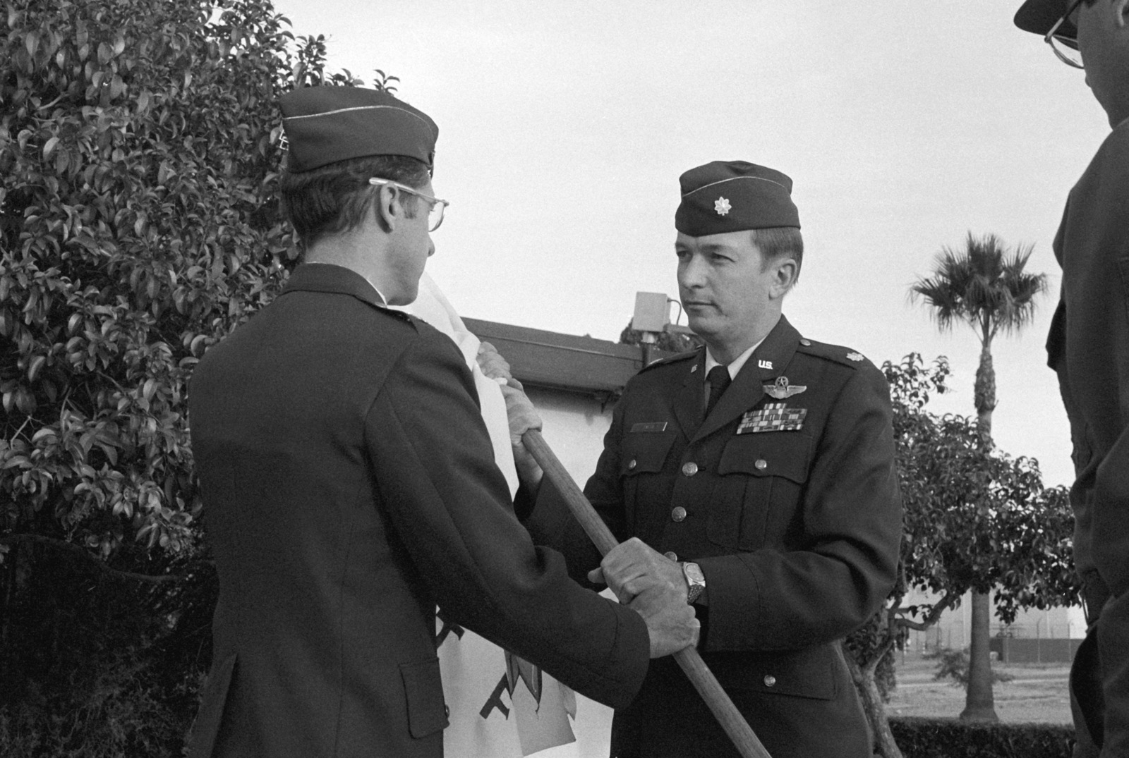 Lieutenant Colonel (LTC) Eugene A. Smith, right, relieves Colonel (COL) George M. Cowan during a change of command ceremony for the 358th Tactical Fighter Training Squadron