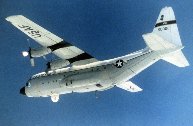 A left underside view of an NC-130A Hercules aircraft in flight with its Airborne Seeker Evaluation Test System (ASETS) turret in the extended position. The ASETS turret permits several air-to-ground sensors or seeks to be tested simultaneously, thus ensuring identical conditions for their comparative evaluation. The aircraft is operated by the Aeronautical Systems Division of Air Force Systems Command