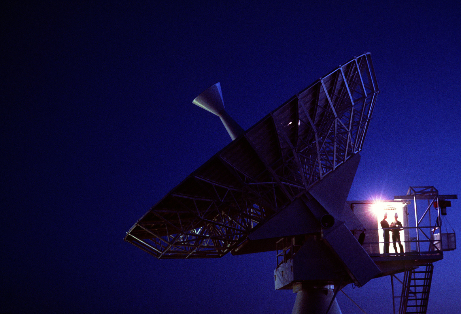 A night view of the Global Positioning System Satellite dish at 1879th Information Services Squadron, Falcon Air Station, Colorado. Exact Date Shot Unknown