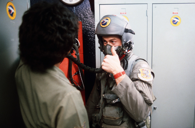 AIRMAN First Class (A1C) Marilyn Stokes, a 78th Tactical Fighter Squadron (TFS) aircrew life support specialist, checks the fit of a flight mask on Lieutenant (LT) Paul Strickland, a 78th TFS pilot, during Exercise REFORGER '86
