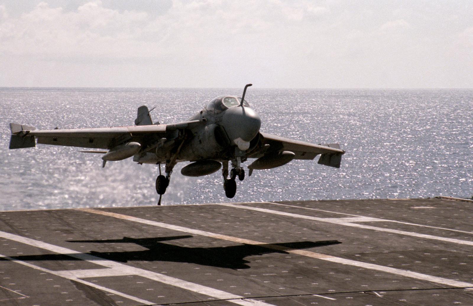 An A-6E Intruder aircraft lands aboard the nuclear-powered aircraft carrier USS DWIGHT D. EISENHOWER (CVN 69)