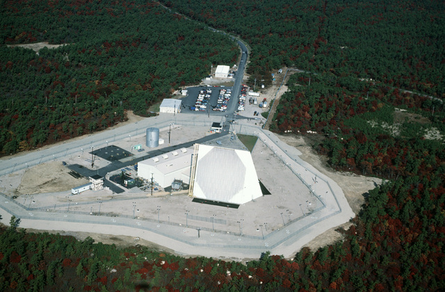 An aerial view of a Pave Paws phased array warning system radar site at Cape Cod Air Force Station