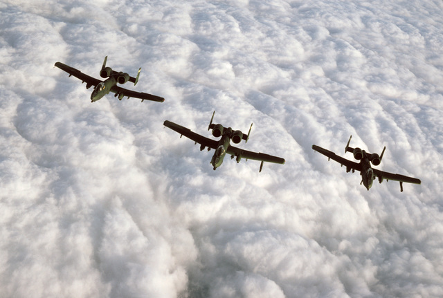 An air to air front view of three 81st Tactical Fighter Wing A-10 Thunderbolt II aircraft in formation during Certain Sentinel, a part of Exercise REFORGER '86