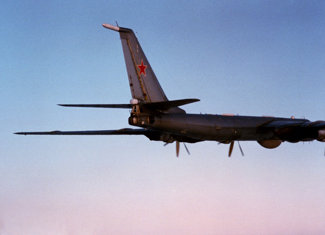 An air to air right rear view of the tail section of a Soviet Tu-142 Bear F aircraft
