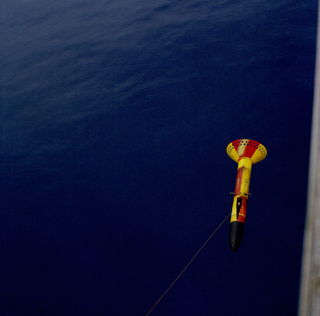 An AN/ASQ-81(V)-2 Magnetic Anomaly Detector (MAD) system sonobuoy is lowered from a helicoptor. (Exact date shot unknown)