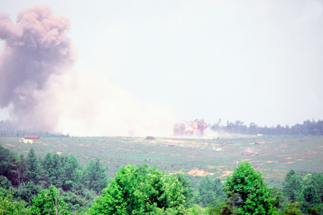 An explosion from a munition dropped by a Marine AV-8A Harrier aircraft during an exercise