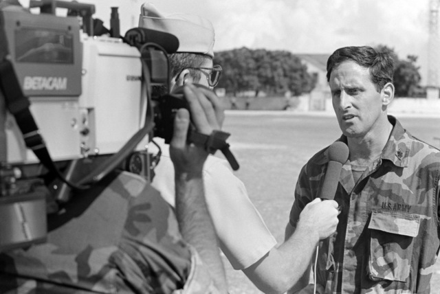 Major (MAJ) Miles Euro is interviewed by a military video camera team about his participation in UPWARD KEY '87, a joint exercise of US and Antigua and Barbuda Defense Forces