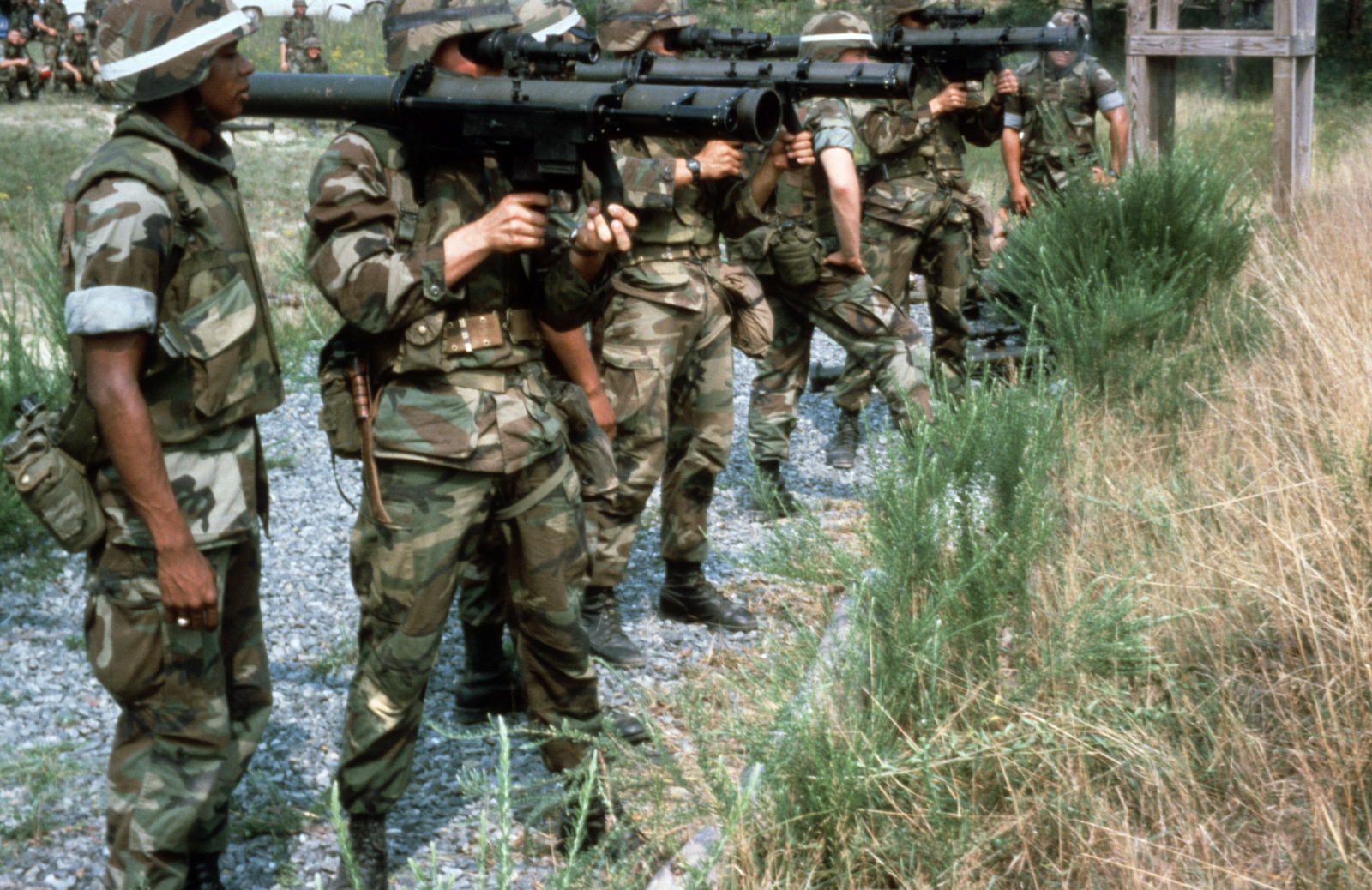 Marines are instructed on the firing of medium anti-tank weapons equipped with sub-caliber training simulators