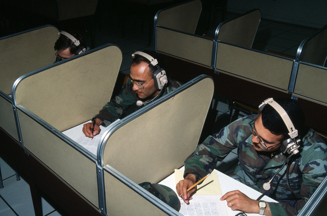 Marines attend a foreign language class in a language laboratory