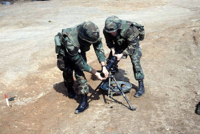 Marines dismantle an M224 60 mm mortar during an infantry officer training course