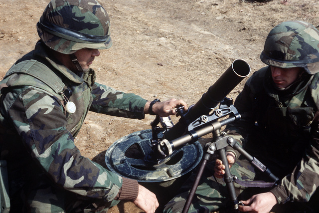 Marines set up an M224 60 mm mortar during an infantry officer training course