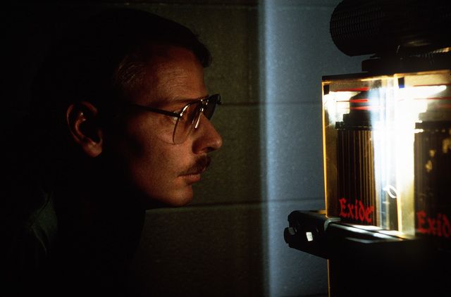 MSGT Darrell R. Mullens, NCOIC of Power Production, check the electrolyte level on a battery terminal at 1879th Information Services Squadron, Falcon Air Station, Colorado. Exact Date Shot Unknown