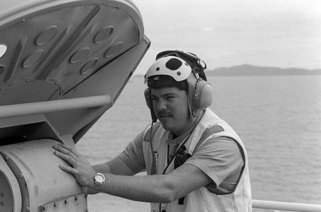 Radioman SEAMAN Rick Taqinta performs a routine check on a satellite communications antenna aboard the amphibious assault ship USS TARAWA (LHA 1) during Exercise COBRA GOLD '86
