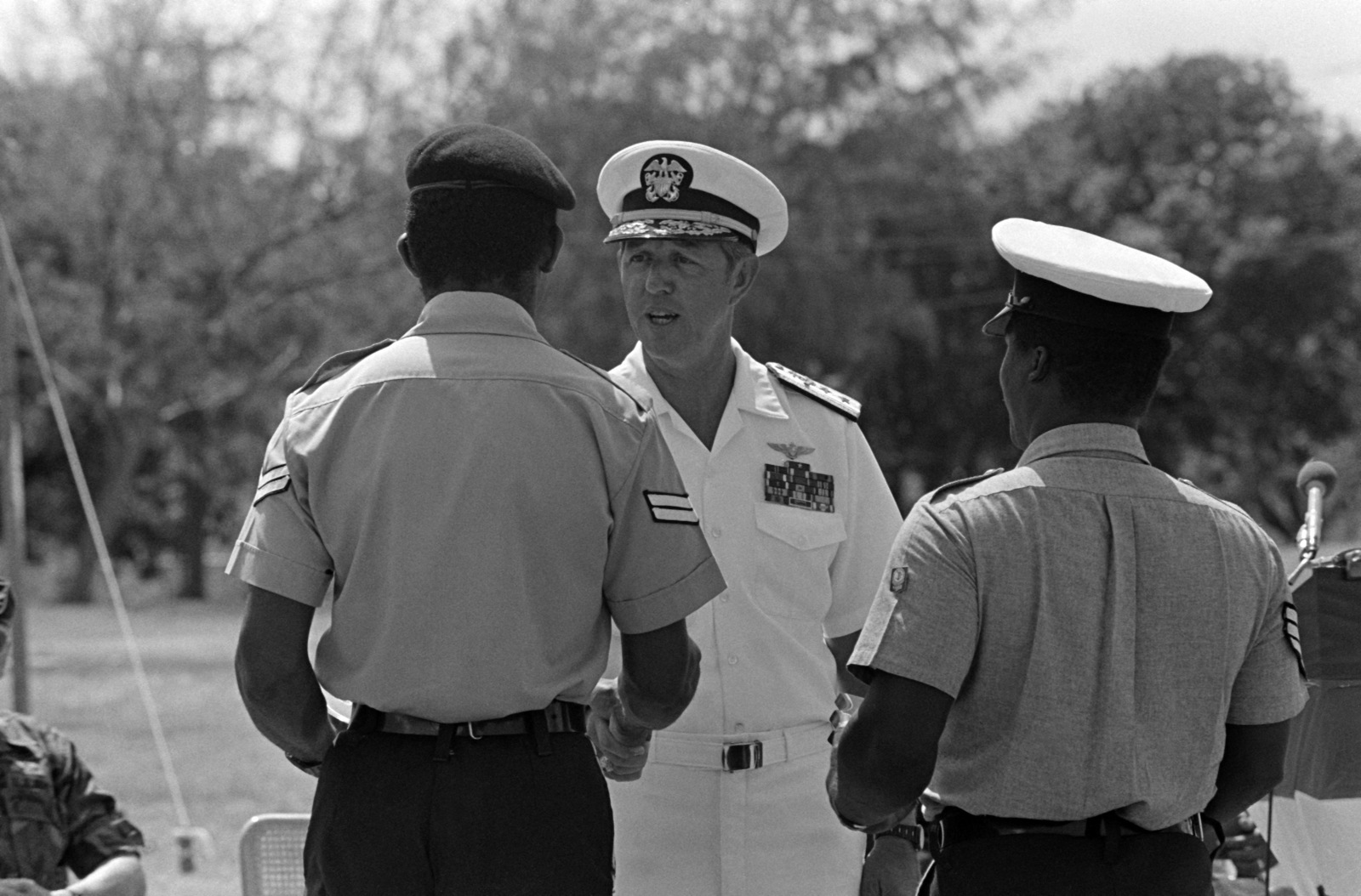 Rear Admiral (RADM) (upper half) Ted C. Steele Jr., commander, US Forces, Caribbean, gives awards to Antigua and Barbuda Defense Force members during the closing ceremonies of UPWARD KEY '87, a joint exercise of US and Antigua and Barbuda Defense Forces