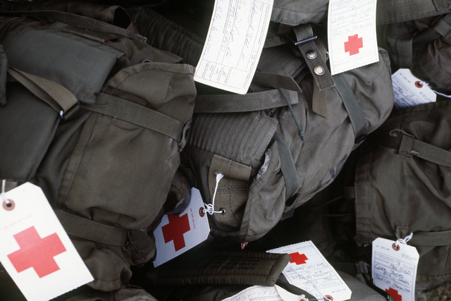 US Army personnel packs with medical tags await transport to Ramstein Air Base during Certain Sentinel, a part of Exercise REFORGER '86