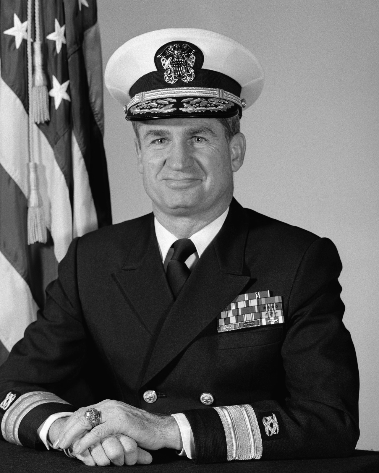 Rear Admiral (lower half) David E. Bottorff, USN (covered)