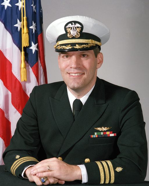 Commander (CDR) Lee R. Mandel, USN (covered)