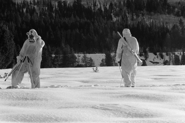 Marine observers watch as Marines from the Scout Sniper Platoon, 23rd Marines, 5th Marine Division, participate in a cold weather training exercise