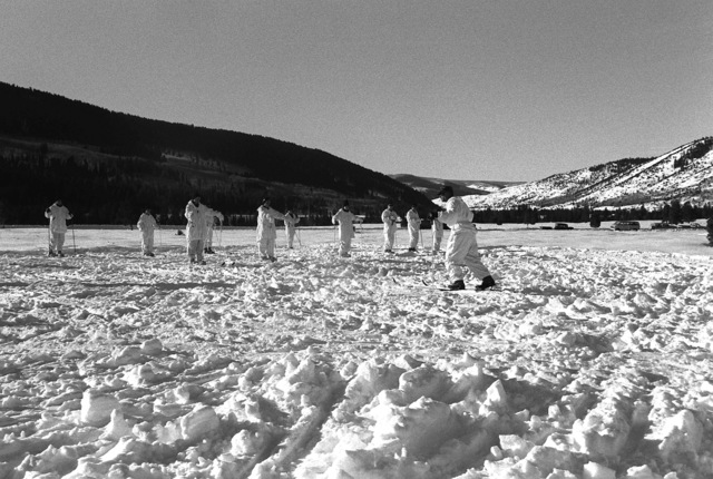 Marines from the Scout Sniper Platoon, 23rd Marines, 5th Mar. Div., practice their skiing during a cold weather training exercise