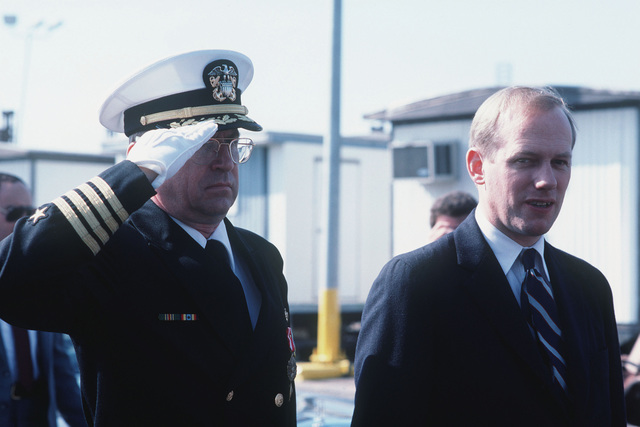 Deputy Secretary of Defense William H. Taft IV is accompanied by Captain (CAPT) George W. Dowell III, supervisor, Shipbuilding, Conversion and Repair, at the commissioning of the guided missile cruiser USS VALLEY FORGE (CG 50)