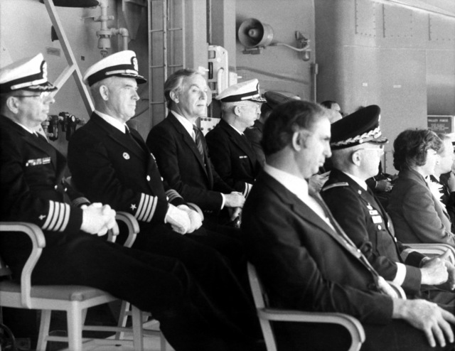 Distinguished guests listen to speeches during the commissioning of the guided missile cruiser USS VALLEY FORGE (CG-50)