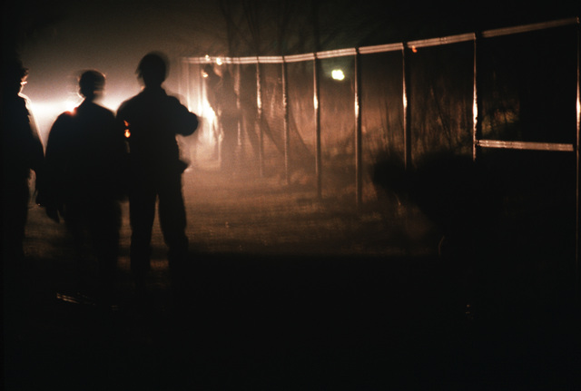 Members of the 1606th Civil Engineering Squadron work at night to complete a chain link fence during the mission capability inspection PURPLE DUCK '86-12