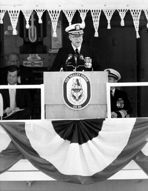 Rear Adm. John F. Shaw, program manager, Aegis Shipbuilding, speaks during the commissioning of the guided missile cruiser USS VALLEY FORGE (CG-50)